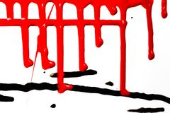 Flows of red paint. Flows of red thick paint on white background royalty free stock images