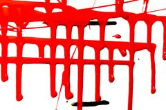 Flows of red paint. Flows of red thick paint on white background royalty free stock photos