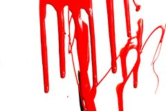 Flows of red paint. Flows of red thick paint on white background royalty free stock photography