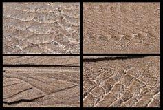 Flüssiges Wasser vier auf Sandmustern Stockbild