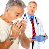 Flu. Doctor and man having the flu. Isolated over white background stock photography