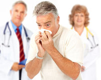 Flu. Doctors and man having the flu. Isolated over white background royalty free stock photos