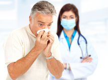 Flu. Doctor and man having the flu. Over white background royalty free stock photo