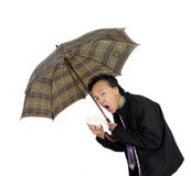flu. Man with umbrella and handkerchief.  flu  sick cough cold sneeze  illness old age man Royalty Free Stock Photo