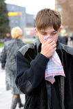 Flu. Attack of the flu on the street Stock Photo