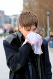 Flu. Attack of the flu on the street Stock Images