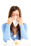 Flu, allergy. Young woman having flu or allergy. Isolated over white background Royalty Free Stock Photo