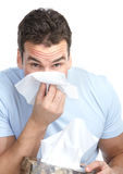 Flu, allergy. Young man having flu or allergy. Isolated over white background Royalty Free Stock Photo