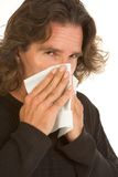 Flu allergy affected middle aged man with tissue Royalty Free Stock Image