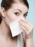 Flu allergy. Sick girl sneezing in tissue. Health Stock Images