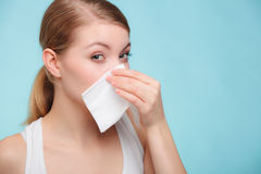 Flu allergy. Sick girl sneezing in tissue. Health Stock Photo