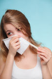 Flu allergy. Sick girl sneezing in tissue. Health Royalty Free Stock Image