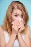 Flu allergy. Sick girl sneezing in tissue. Health Stock Image