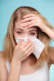 Flu allergy. Sick girl sneezing in tissue. Health Royalty Free Stock Photo