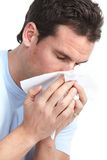 Flu, allergy. Young man having flu or allergy. Isolated over white background royalty free stock images