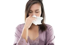 Flu. Asian Women In Satin Nightwear Feeling Unwell And Sneeze Against White Background, Dust Allergies, People Caught Cold And Allergy Stock Photography