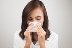 Flu. Business woman sneezing while working in office, Businesswoman having flu Stock Images