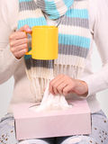 Flu cold. Sick woman with cup of tea and tissue box Royalty Free Stock Photography