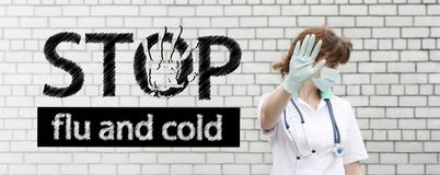 Flu and cold stop concept. photo with text. For your design. the inscription on the white brick background. girl doctor in meditsynskoy mask and with a Royalty Free Stock Photography
