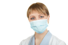 Flu epidemic. Closeup of a doctor wearing a protection mask Royalty Free Stock Image