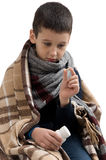 Flu epidemic. Boy ill flu. boy taking pills. Seasonal flu epidemic. Boy ill flu. boy taking pills Stock Photography