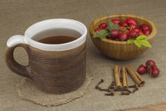 A flu epidemic. Traditional home treatment for colds and flu. Rosehip tea, honey and citrus. Royalty Free Stock Photos