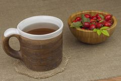 A flu epidemic. Traditional home treatment for colds and flu. Rosehip tea, honey and citrus. Royalty Free Stock Images