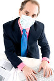 Flu prevention at work. Businessman with medical mask for Flu prevention at work Royalty Free Stock Images