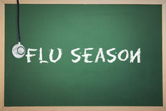 A Flu season against chalkboard Stock Photo