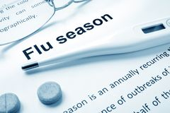 Flu season sign on a paper. Flu season sign on a paper and glasses Stock Image