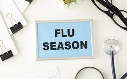 Free Flu Season Written On A Paper On Table Royalty Free Stock Photo - 196443145