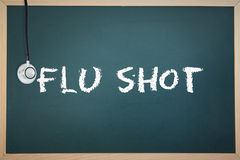 A Flu shot against chalkboard Stock Photography