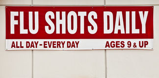 Flu shots sign. Posted outside royalty free stock image