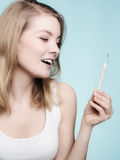 Flu. Sick girl checking thermometer. Health. Stock Images