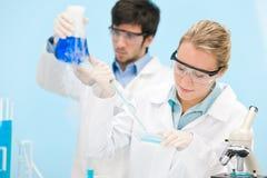 Flu virus experiment -  scientist in laboratory Stock Photo