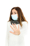 Flu woman with a virus mask giving stop sign Royalty Free Stock Image