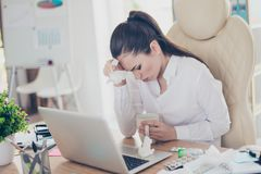 Flu at work. Tired sick business lady lawyer with strong migraine grimace. She is wearing the formalwear, sitting. At the office, touching her forehead stock images
