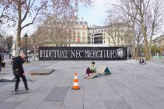 The Fluctuat Nec Mergitur City of Paris motto. PARIS, FRANCE -Fluctuat Nec Mergitur (Tossed but does not sink) is the motto of the city of Paris. It has become a stock images