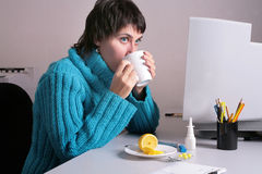 Flue. Woman in the office feels she is getting ill Royalty Free Stock Images