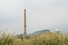 Flue of rice mill. Crate of rice mill Smoke from the rice paddy stock photography