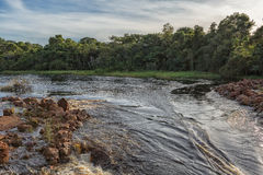 Fluent African river in Angola. With sunset Stock Images