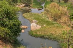 Fluent river with rocks and vegetation in Africa. Lubango. Angol. A Royalty Free Stock Photos