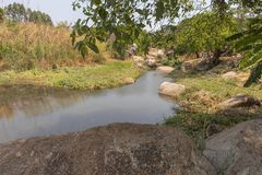 Fluent river with rocks and vegetation in Africa. Lubango. Angol. A Stock Images