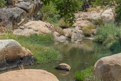 Fluent river with rocks and vegetation in Africa. Lubango. Angol. A Royalty Free Stock Images