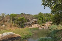 Fluent river with rocks and vegetation in Africa. Lubango. Angol. A Royalty Free Stock Photography