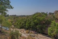 Fluent river with rocks and vegetation in Africa. Lubango. Angol. A Royalty Free Stock Image