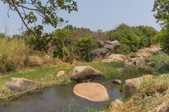 Fluent river with rocks and vegetation in Africa. Lubango. Angol. A Stock Photography