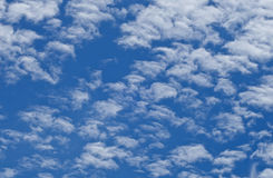 Fluff clouds background Stock Images