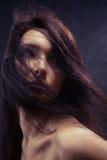 fluffig hårkvinna royaltyfria foton