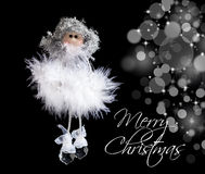 Fluffy angel and christmas lights Stock Photo